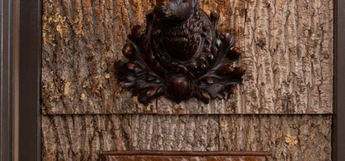 Hall sconce with room name
