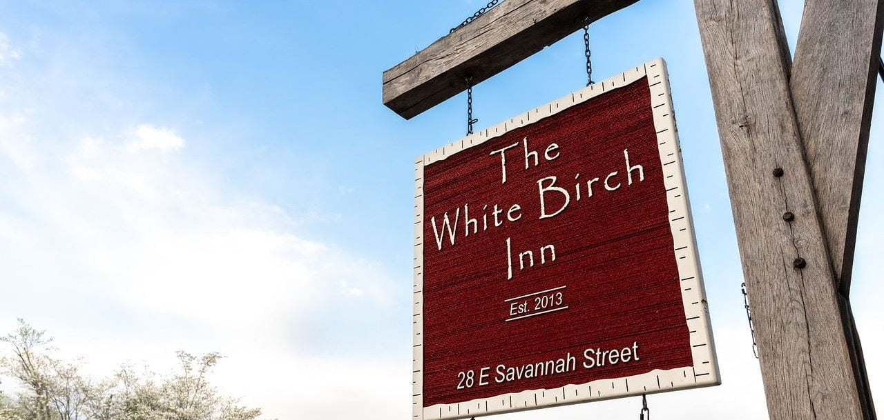 White Birch Inn sign mountain in view