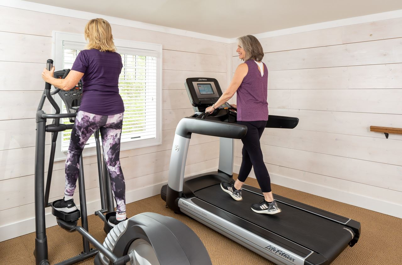 Gym with two people on equipment
